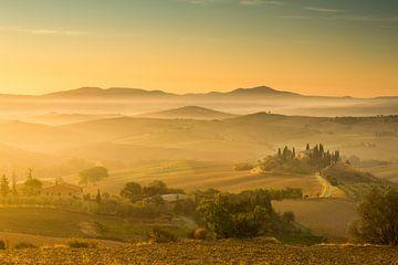 De gouden zonnestralen in Toscane