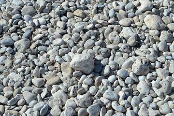 Grijze stenen in het zand van Alphapics
