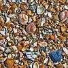 Honderden kleine kunstwerken op het strand van Art by Jeronimo thumbnail