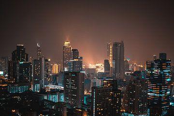 Skyline van Bangkok in de nacht van Bart van Lier