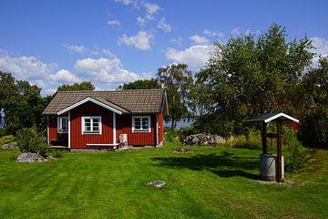 Traditioneel Zweeds huisje. van Jarretera Photos