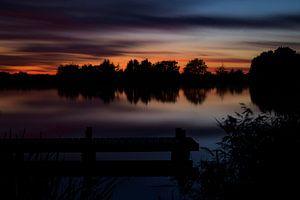 Uitzicht op de Rotte bij avondlicht van Wim van der Wind