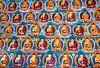 Muurschildering met boeddha's in Tibetaans klooster van Rietje Bulthuis thumbnail