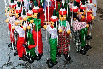 Pinocchio as a puppet on a string von e-STER design