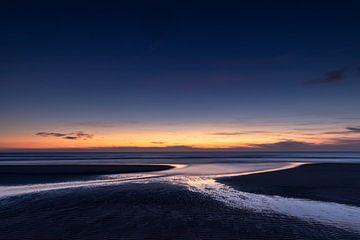 Coucher de soleil depuis la plage de Zélande à Vrouwenpolder sur