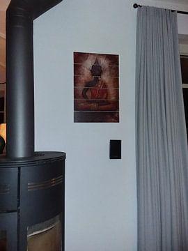 Klantfoto: Oranje Boeddha van Claudia Moeckel