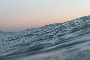 Golven bij zonsondergang | Surffotografie Scheveningen Nederland
