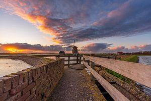 Moulinez le coucher de soleil de North Texel