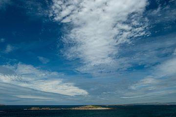 Wolken en zee in Ierland