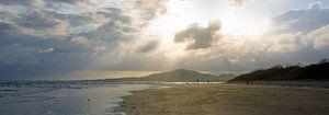 Zonnestralen op  strand