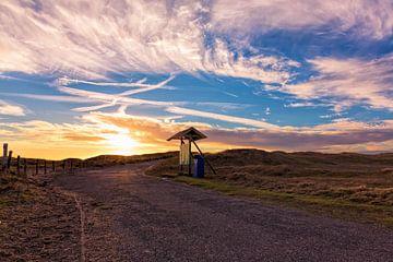 Zonsondergang bij duingebied omgeving Den Helder van eric van der eijk