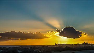 Zon en wolk boven Maspalomas, Gran Canaria van
