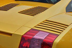 Close-up van een gele Lamborghini Gallardo.