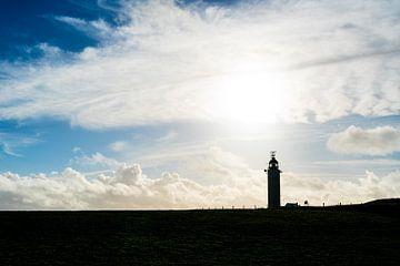 Silhouette des Leuchtturms mit Wolken von Mickéle Godderis