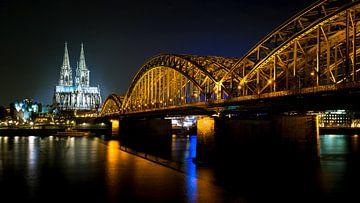 De Dom en de Hohenzollernbrücke in Keulen van Karel Pops