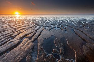 Eb en zonsondergang bij Moddergat van