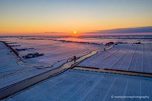 Zonsopkomst in de sneeuw van Martijn de Ruijter