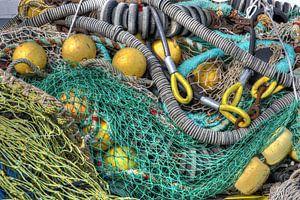 Visnetten liggen te drogen na het vissen