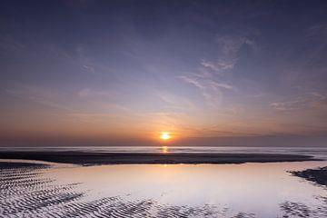 Coucher de soleil sur la plage en Zélande sur