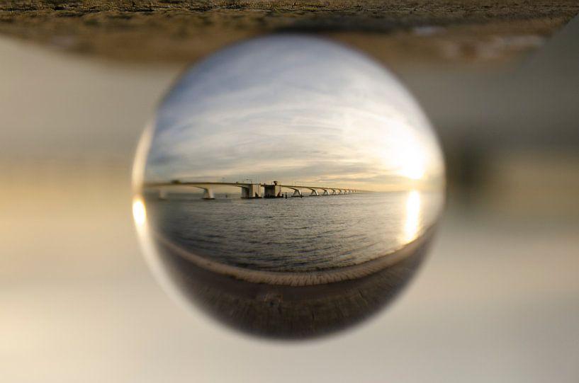 Zeelandbrug door een glazen bol van Annelies Cranendonk