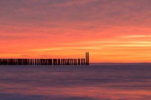Zonsondergang strand Domburg van Zeeland op Foto