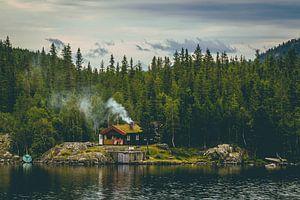 Het huisje aan het meer. van