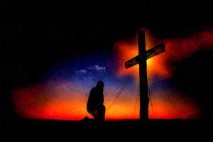 Knielen voor het kruis