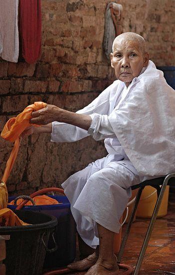 Nun doing laundry