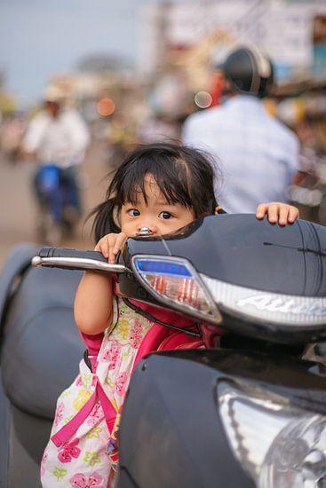 Portrait of a little girl on a motorbike