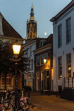Verlichte O.L.V kerktoren in Amersfoort bij maanlicht van Karin Riethoven