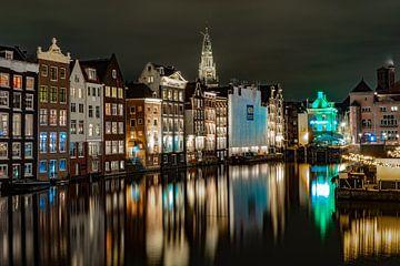 Damrak kanaal in avondlicht von Henk Goossens