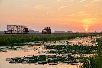 Zonsondergang in de polder van Hanno de Vries