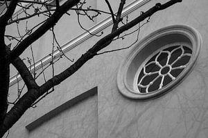 Rond venster in de  Archipelbuurt Den Haag