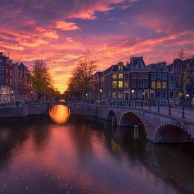 Zonsondergang Amsterdam van Dick van Duijn