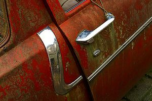 Detail of rusty old red car.