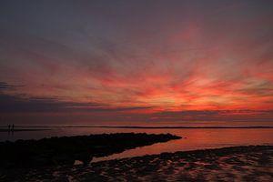 Zonsondergang buitenwatering Katwijk aan Zee van