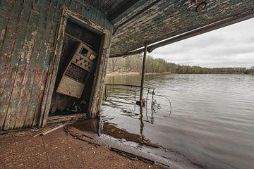 Half sunken boathouse near Chernobyl van Andreas Jansen