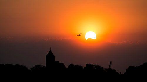 Vreugderijkerwaard bij zonsondergang