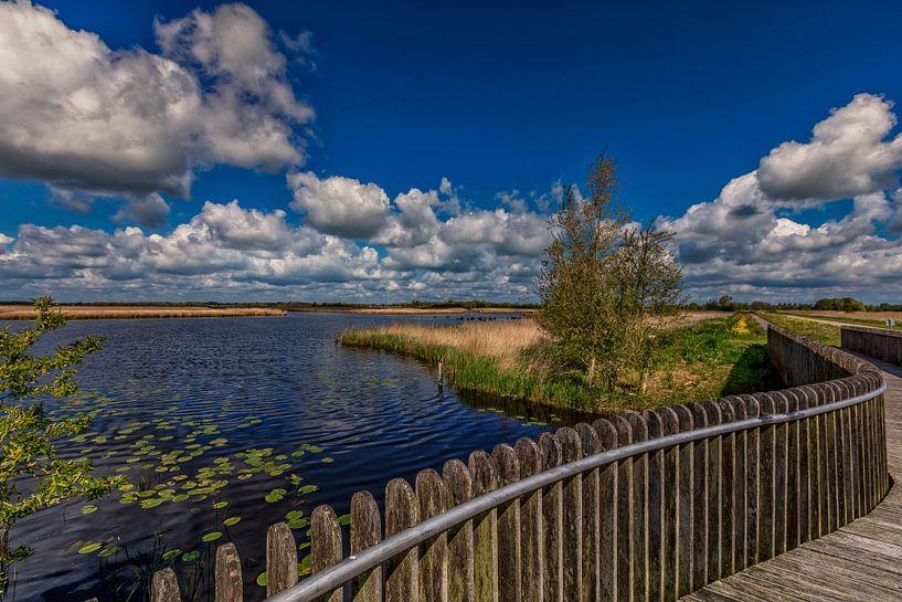 Wolkenpracht boven natuurgebied de Onlanden van Jacques Jullens