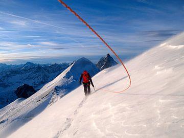 Un alpiniste au sommet du Breithorn