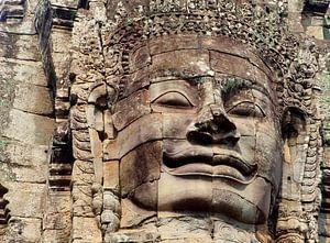 Stenen glimlach Boeddha uit de oudheid, Angkor Wat Cambodja van