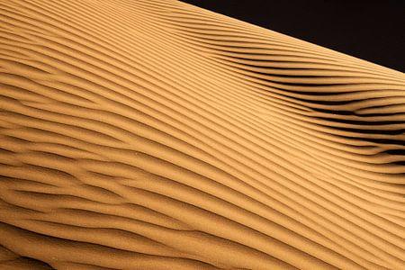 Schaduwen in het zand