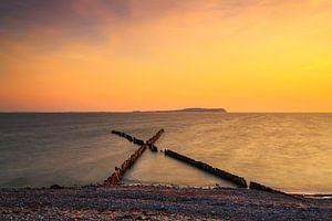 Buhnen im Sonnenuntergang am Strand von Rügen