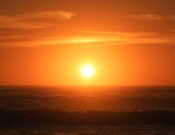 Opgaande zon in Moeraki, Nieuw-Zeeland van J V