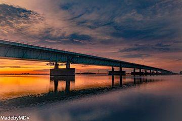 Pont de mouche à hareng au coucher du soleil sur Marcel de Vos
