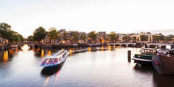 Excursion boat near Magere Brug bascule bridge in Amsterdam sur