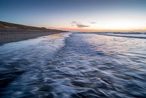 Zonsondergang met zicht op Zandvoort van