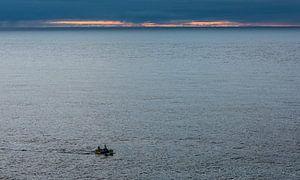 Visserman op zee van