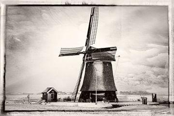Hollandse windmolen in een winterlandschap van eric van der eijk