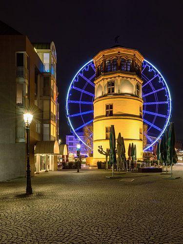 Castle tower in Dusseldorf and blue ferris wheel van